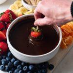 strawberry dipped into chocolate fondue