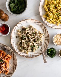 three bowls of pasta with different sauces